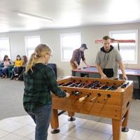 Students playing foosball